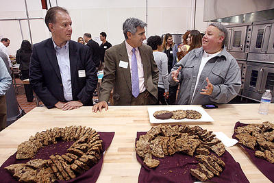 Tia Meyer of the San Lorenzo Valley, talks about her three-chocolate cookies with pecans and brown sugar at Monday's grand opening of El Pajaro Community Development Corporation's incubator commercial kitchen in Watsonville. (Dan Coyro/Sentinel) ( Dan Coyro )